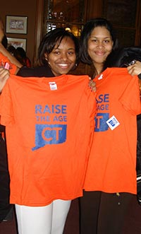 Two teenage girls show their support for Raise the Age CT
